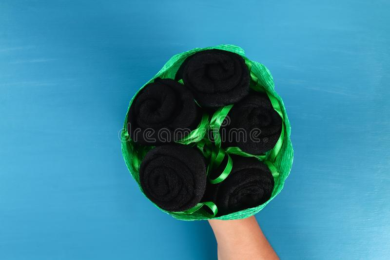 Diy father's day bouquet black roses socks blue background. Gift idea, decor Father day, Daddy. 10 Diy father's day bouquet black roses socks blue background royalty free stock images