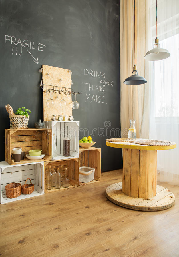 DIY furniture from crates and cable stool. DIY furniture from wooden crates and cable stool in upcycled interior stock photo