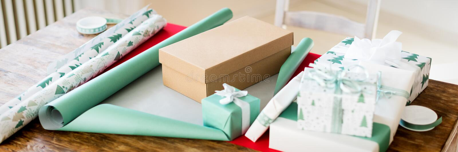 DIY Gift Wrapping. Beautiful nordic christmas gifts on wooden table. Christmas wrapping station banner. royalty free stock photography