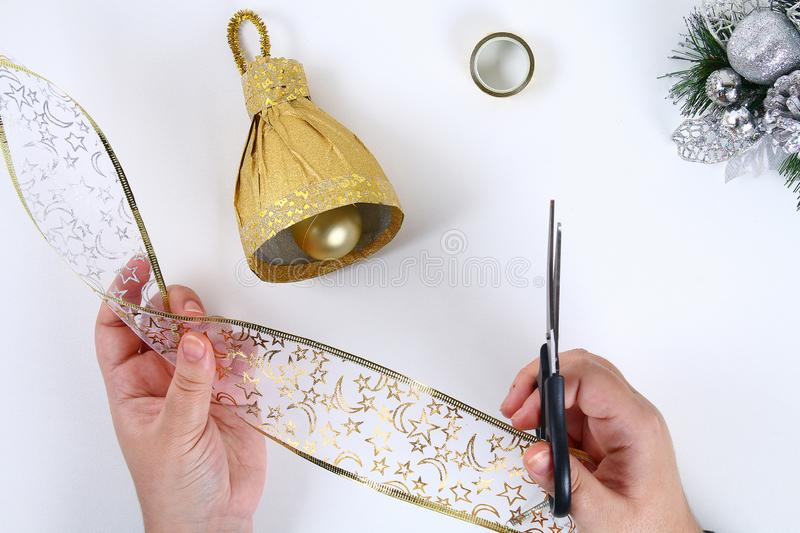 DIY gold bell from a plastic bottle. Guide on the photo how to make a decorative bell from a bottle, paper and a Christmas ball stock image