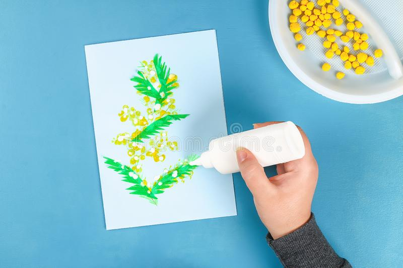 Diy greeting card with mimosa flowers paper balls for March 8 on blue background. Gift idea, decor International Womens Day, March 8, Mother day. Step by step stock photos
