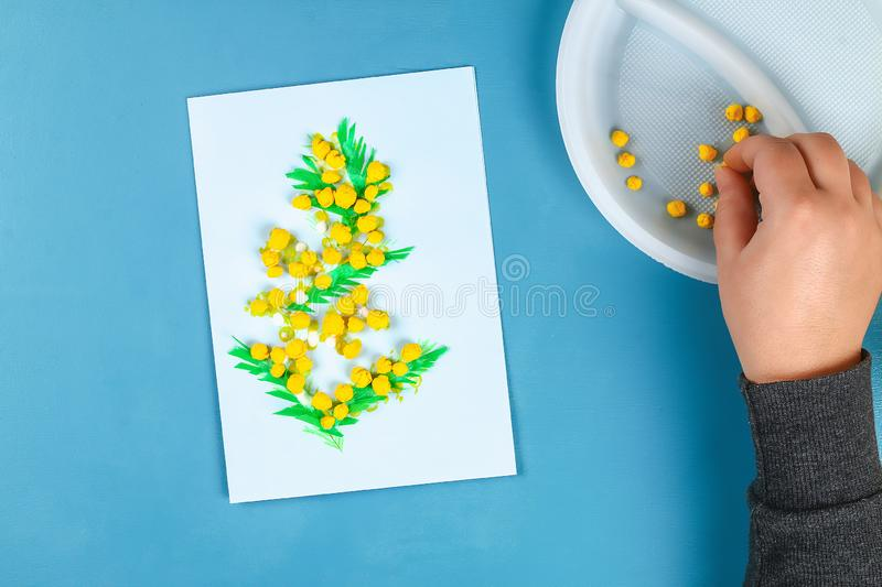 Diy greeting card with mimosa flowers paper balls for March 8 on blue background. Gift idea, decor International Womens Day, March 8, Mother day. Step by step stock images