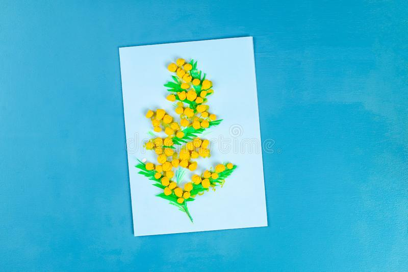 Diy greeting card with mimosa flowers paper balls for March 8 on blue background. Gift idea, decor International Womens Day, March 8, Mother day. Step by step royalty free stock images