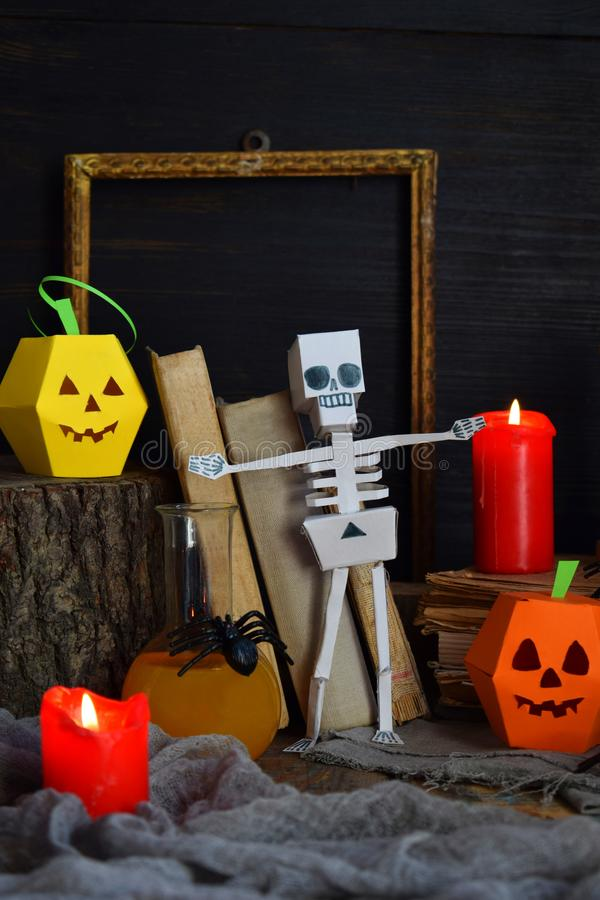 DIY Halloween decor - pumpkin and skeleton from paper, spider. Children crafts for party. Holiday decoration. Greeting card with c royalty free stock photography