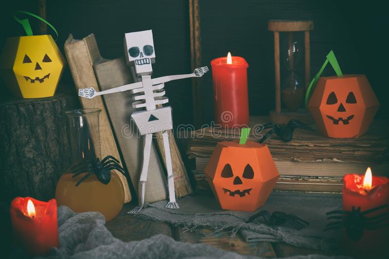 DIY Halloween decor - pumpkin and skeleton from paper, spider. Children crafts for party. Holiday decoration. Greeting card with c stock image