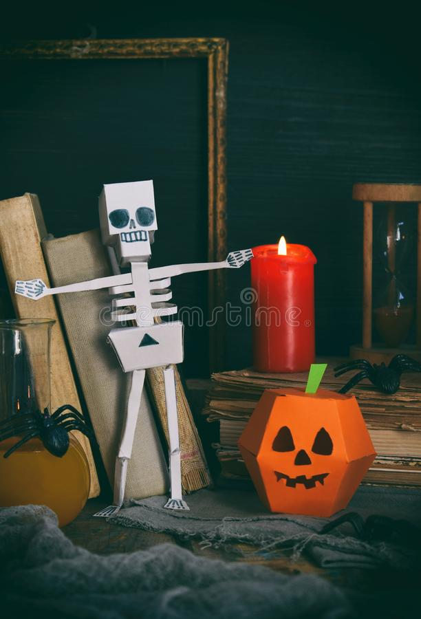 DIY Halloween decor - pumpkin and skeleton from paper, spider. Children crafts for party. Holiday decoration. Greeting card with c royalty free stock image