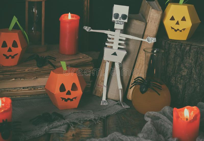 DIY Halloween decor - pumpkin and skeleton from paper, spider. Children crafts for party. Holiday decoration. Greeting card with c royalty free stock images
