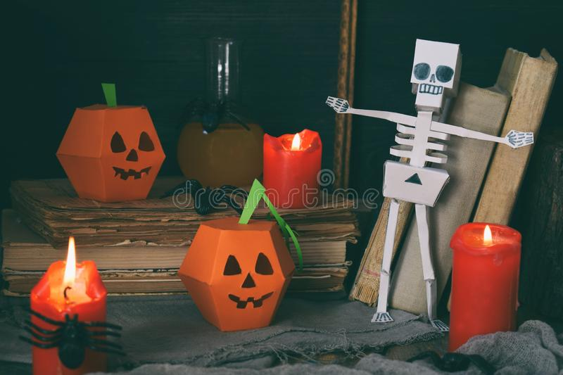 DIY Halloween decor - pumpkin and skeleton from paper, spider. Children crafts for party. Holiday decoration. Greeting card with c royalty free stock photo