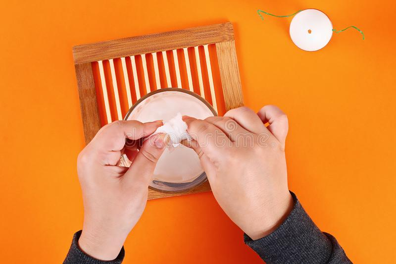 Diy Halloween ghost of starch and gauze orange background. Gift idea, decor Halloween. Step by step stock image