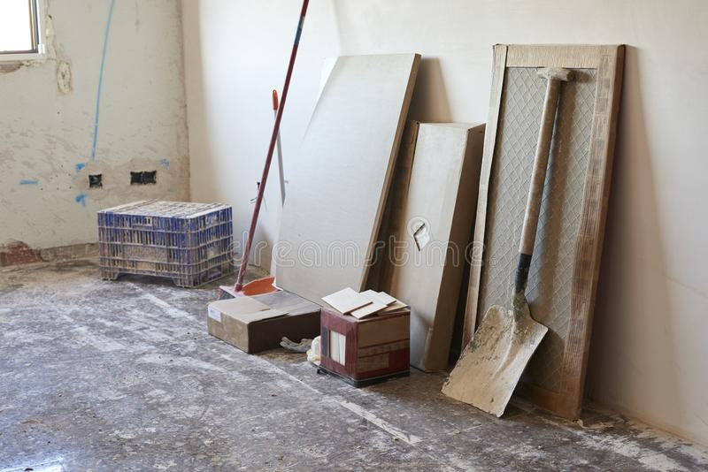 DIY, house indoor improvements in a messy room construction. Reform renovation repair flat apartment tools home architecture bricolage built concrete cracked stock photography