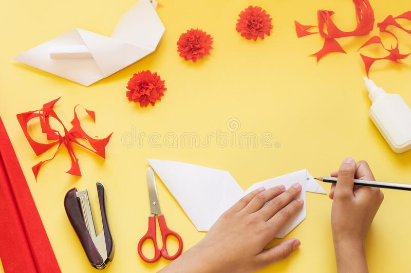 DIY instructions. How to make card with carnation flowers and origami dove at home. Card to Victory Day 9 May. Step by step photo. DIY instructions. Step by step royalty free stock photo