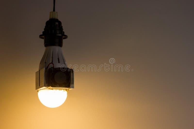 Diy led lamp on light gray background royalty free stock photos