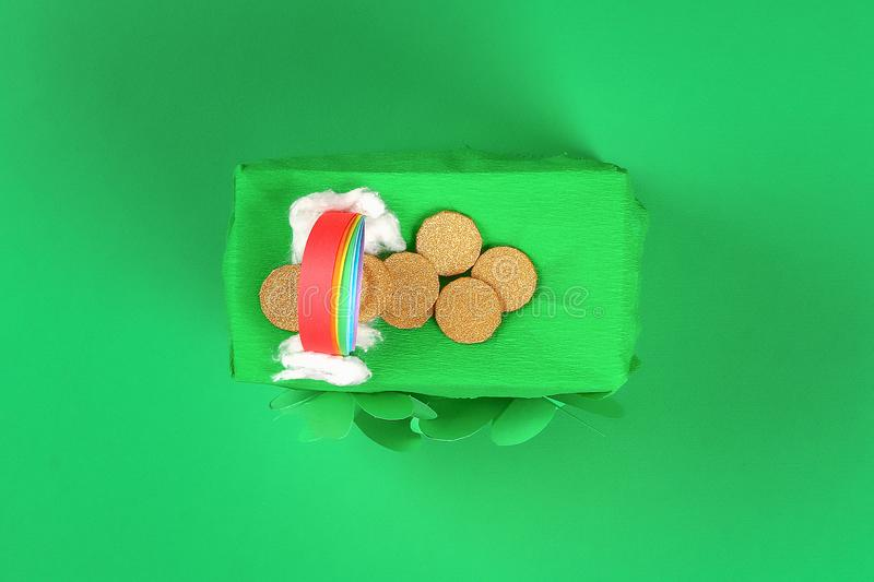 DIY leprechaun trap with gold coins, rainbow and green ladder St Patricks Day background royalty free stock image