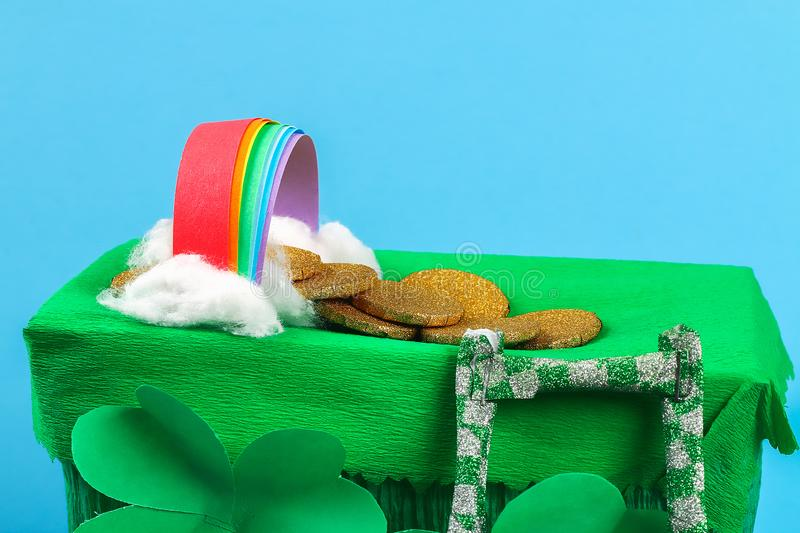 DIY leprechaun trap with gold coins, rainbow and green ladder St Patricks Day background royalty free stock images