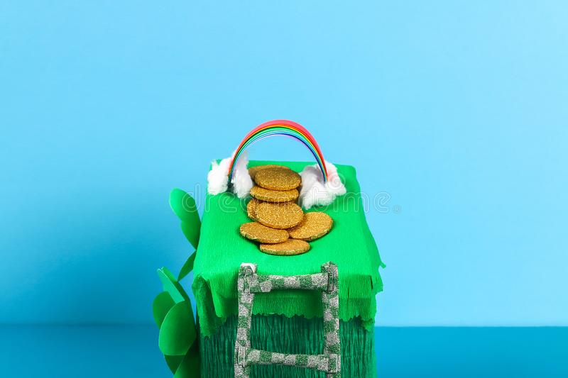 DIY leprechaun trap with gold coins, rainbow and green ladder St Patricks Day background royalty free stock photo