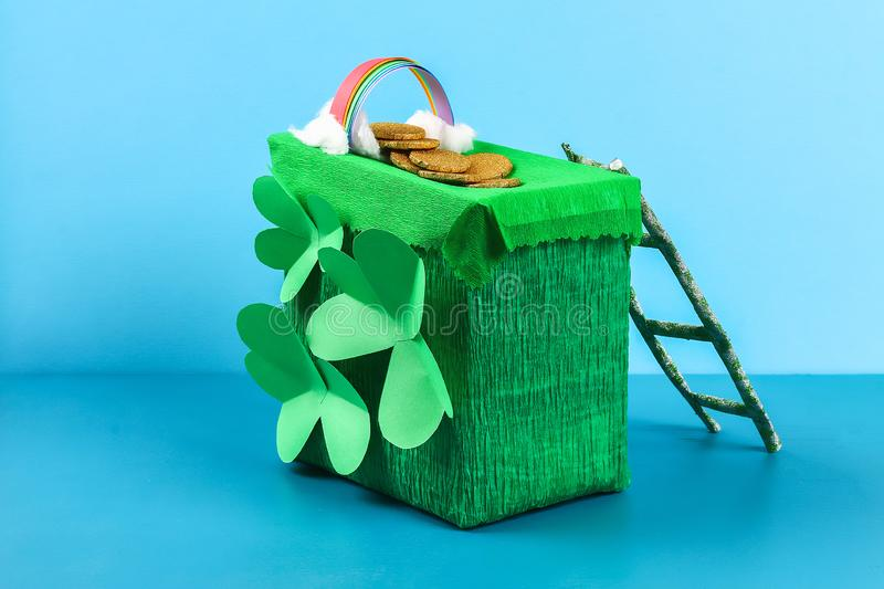 DIY leprechaun trap with gold coins, rainbow and green ladder St Patricks Day background royalty free stock photos