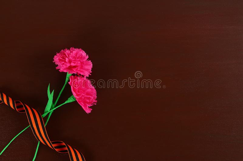 Diy May 9th carnations from crepe paper, wire and napkins. Gift idea, decor 9 May. Step by step. Top view. Process kid children craft. Workshop royalty free stock photo