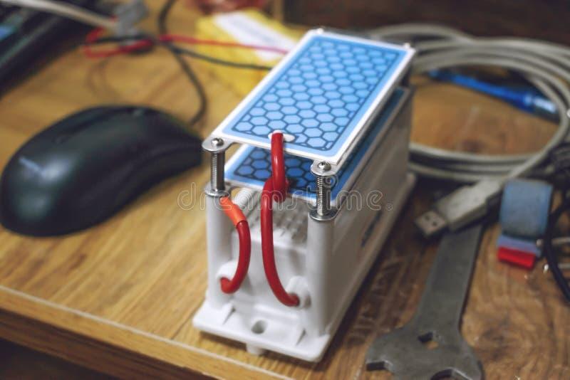 DIY Ozone Generator, ozonizer. Heavy Duty Ozone Generator DIY with Blue Plates Treatment. Selective focus. Application, dryer, dishwasher, refrigerator royalty free stock photography