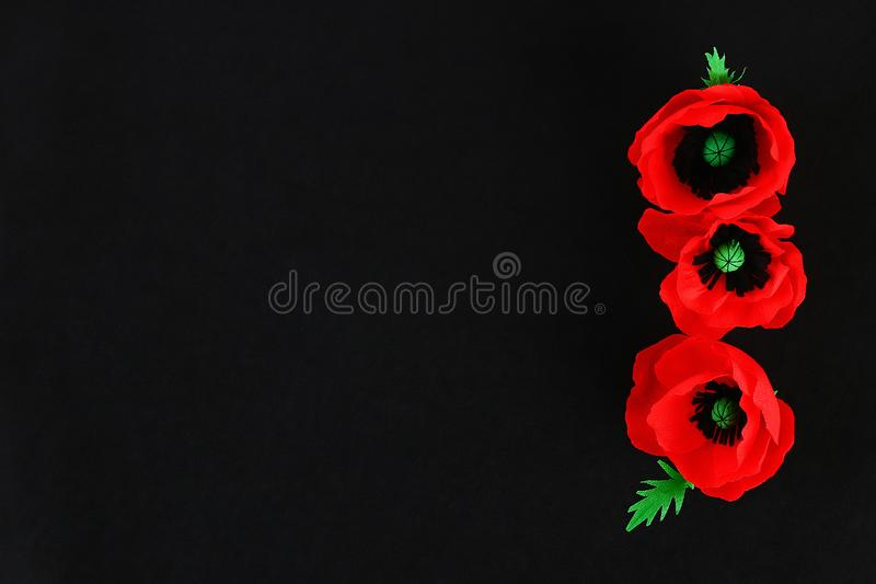 Diy paper red poppy Anzac Day, Remembrance, Remember, Memorial day crepe paper on black background royalty free stock images