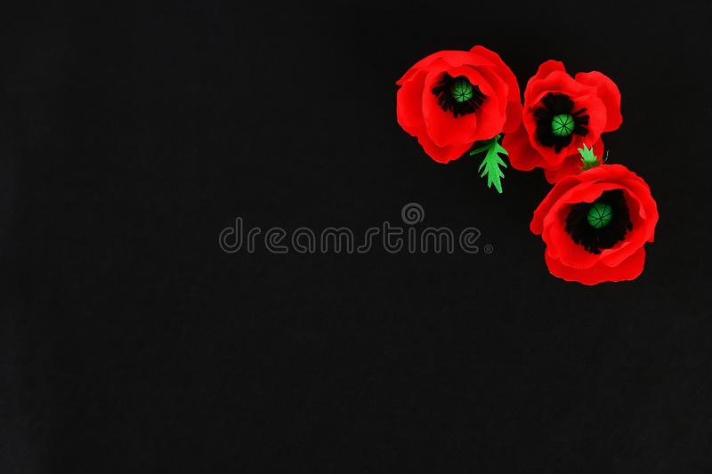 Diy paper red poppy Anzac Day, Remembrance, Remember, Memorial day crepe paper on black background stock photos