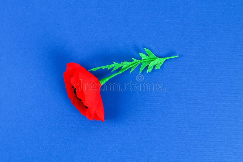 Diy paper red poppy Anzac Day, Remembrance, Remember, Memorial day crepe paper on blue background stock image