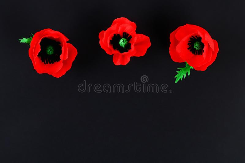 Diy paper red poppy Anzac Day, Remembrance, Remember, Memorial day crepe paper on black background. Diy paper red poppy Anzac Day, Remembrance, Remember royalty free stock photo