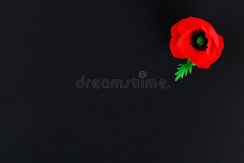 Diy paper red poppy Anzac Day, Remembrance, Remember, Memorial day crepe paper on black background. Diy paper red poppy Anzac Day, Remembrance, Remember royalty free stock image