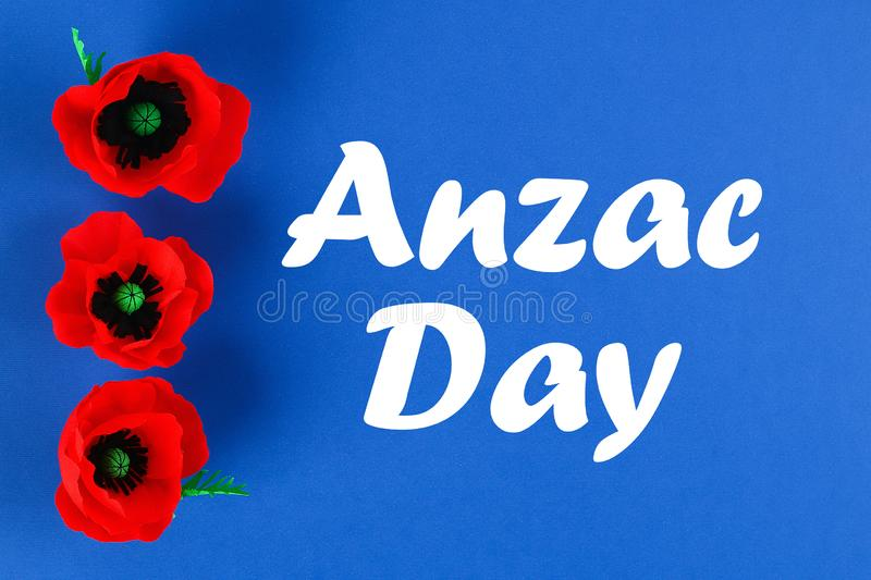 Diy paper red poppy Anzac Day, Remembrance, Remember, Memorial day crepe paper on blue background stock photo