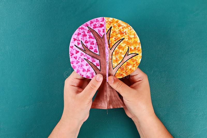 Diy paper tree four seasons summer, autumn, winter, spring. Tree 4 season. Childrens creativity. Gift idea, decor. Step by step. Top view. Process kid children royalty free stock image