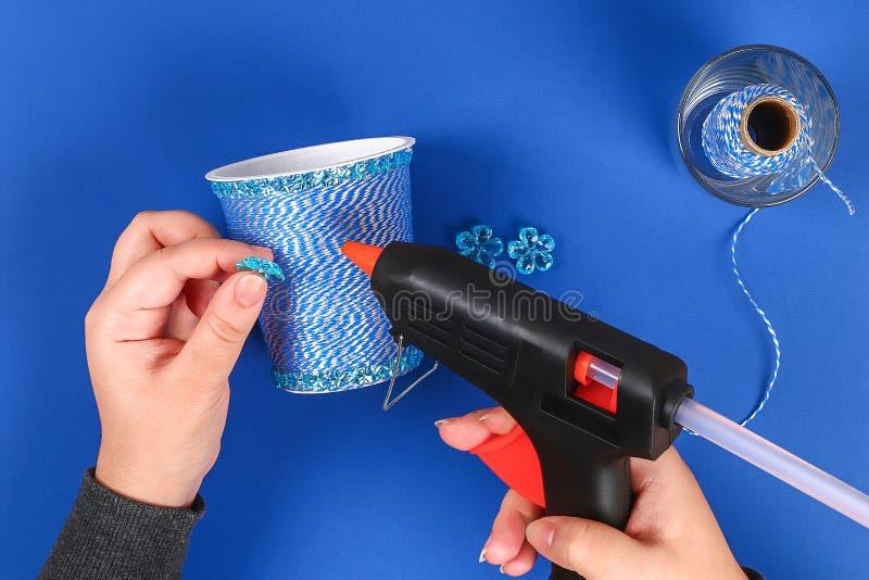Diy pencil holder plastic glass sour cream, yogurt wrapped thread blue background stock images