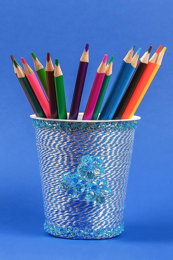 Diy pencil holder plastic glass sour cream, yogurt wrapped thread blue background royalty free stock images