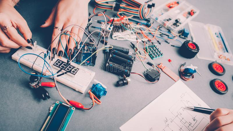Diy rc car model female engineer components. DIY RC car model. Female engineer, electronic components, circuit wires royalty free stock photo