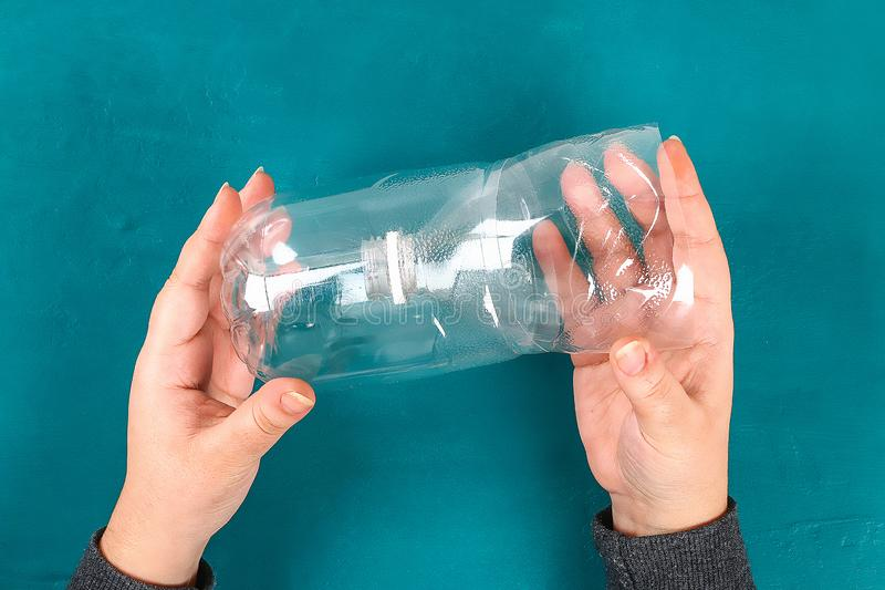 DIY re-use of a plastic bottle for no spill paint cups, water for childrens drawing. Recycling royalty free stock photography