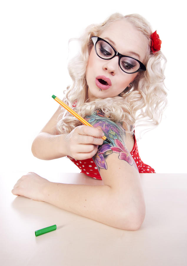 DIY tattoo. Girl drawing a tattoo on a shoulder stock image