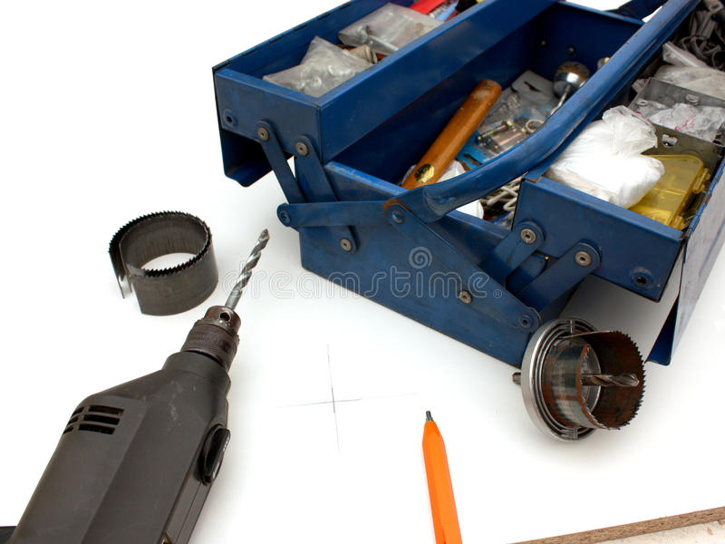 DIY toolbox. An image of an isolated DIY toolbox with drill and an assortment of parts and tools stock image