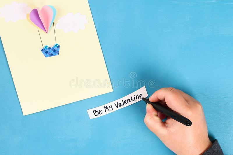 DIY Valentines Day greeting card on 14 february. DIY Valentines greeting card blue wooden background. Gift ideas day love, February 14, Valentines Day. Handmade royalty free stock photo