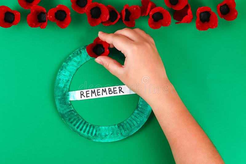 Diy wreath red poppy Anzac Day, Remembrance, Remember, Memorial day made of cardboard egg trays. 13 Diy wreath red poppy Anzac Day, Remembrance, Remember royalty free stock image