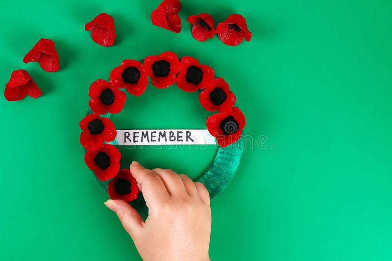 Diy wreath red poppy Anzac Day, Remembrance, Remember, Memorial day made of cardboard egg trays. 14 Diy wreath red poppy Anzac Day, Remembrance, Remember stock photography