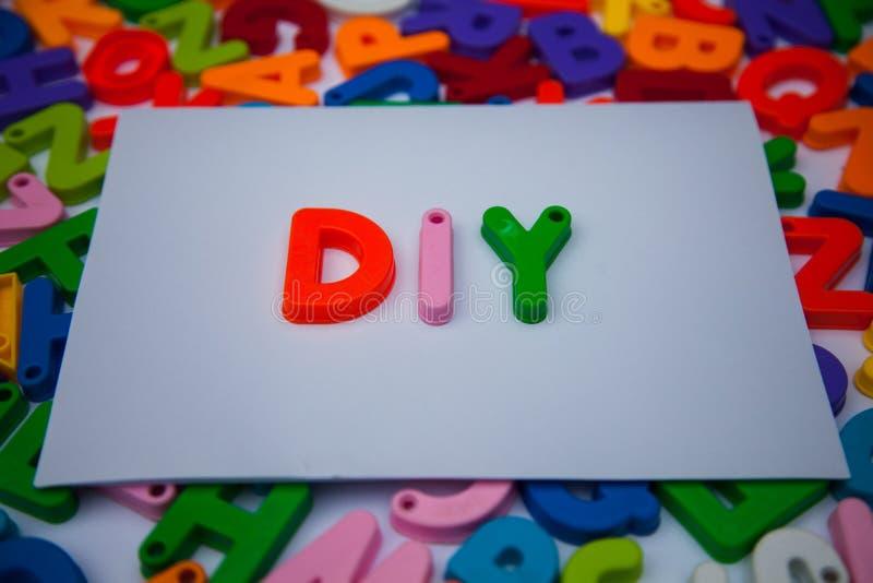 Diy written with alphabet blocks. Diy written alphabet blocks stock images