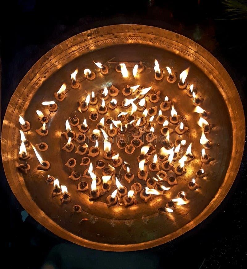 108 diya burning on the big golden plate in maha sandhi puja of goddess durga. Asansol,west bengal,durga maa,kaalratri maa,shailputri,bramhchaarini,kushmaanda royalty free stock photo
