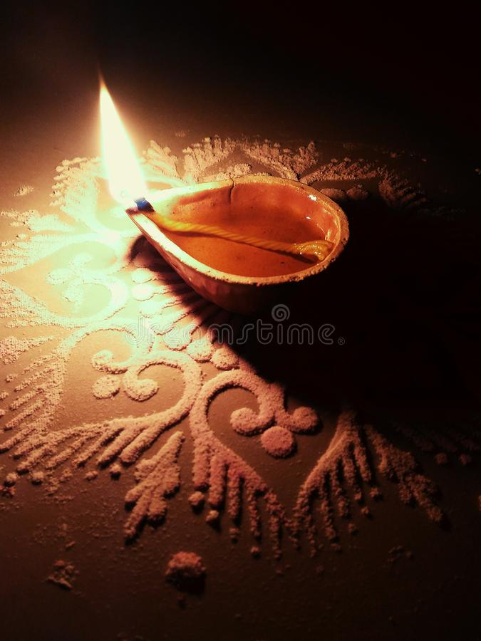 Diya on diwali in india. Diya is a cup made of baked clay and filled with oil having one string, which is burnt to enlighten the darkness stock photos
