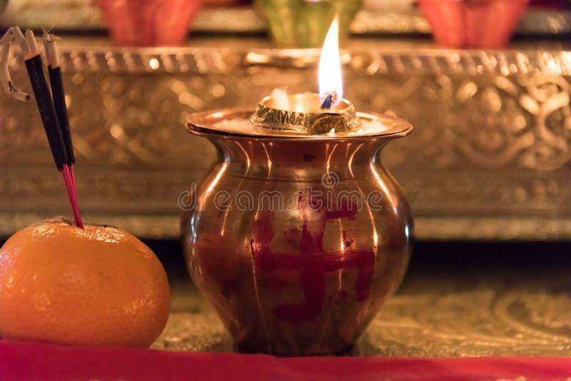 Diya, Kalash and Incense Sticks on Fruit royalty free stock photos