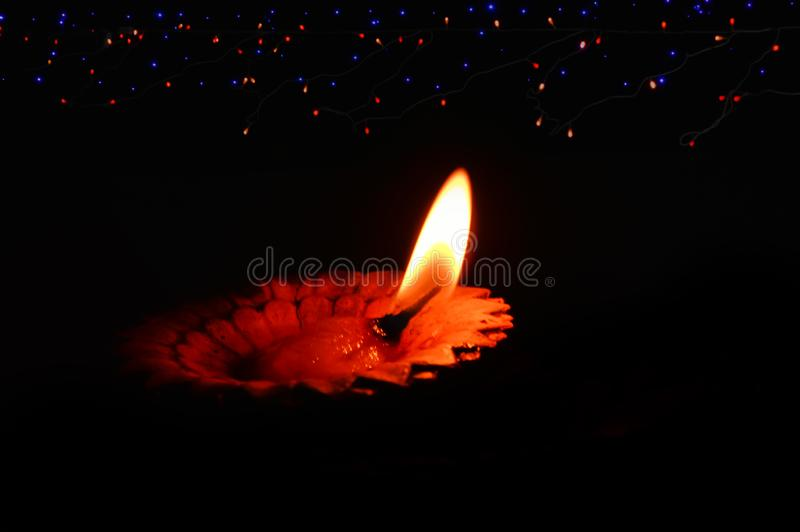 Diya,lighting background and lamp,Happy Diwali - Lit diya lamp on street at night,Diya lamps lit on colorful light during Diwali. Celebration,Hinduism royalty free stock image