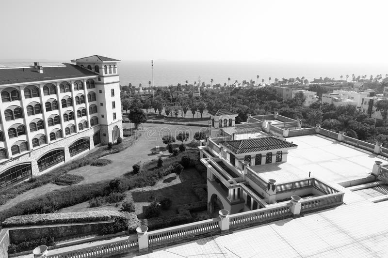 Overlook Xiamen Victoria Hotel at seaside, black and white image. Diyuan Victoria is a platinum five-star standard built with Spanish architectural style and royalty free stock photography