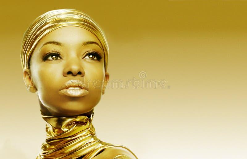 Djärvt och guld- arkivfoto