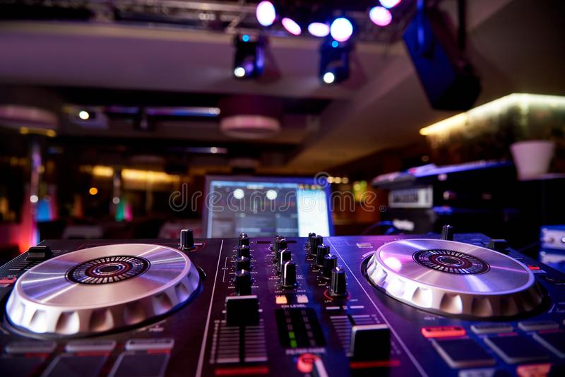 Dj audio mixer controller. On the background of the dance floor royalty free stock image