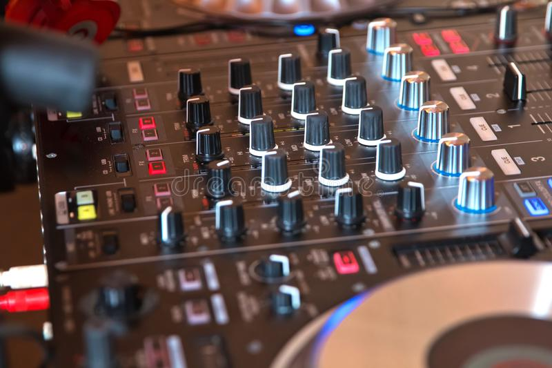 DJ booth at night club party for music mixing. royalty free stock image