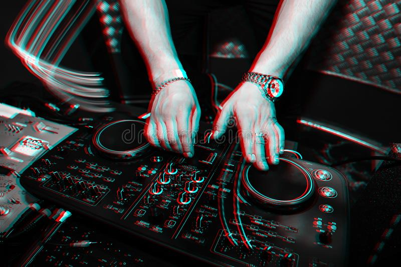 DJ brings music and turns volume on musical equipment. DJ brings the music and turns the volume on musical equipment. Black and white photo with glitch effect royalty free stock photos