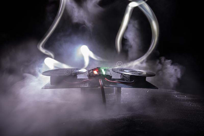 Dj club concept. Creative artwork decoration of dj table on dark toned background with lights and fog stock image