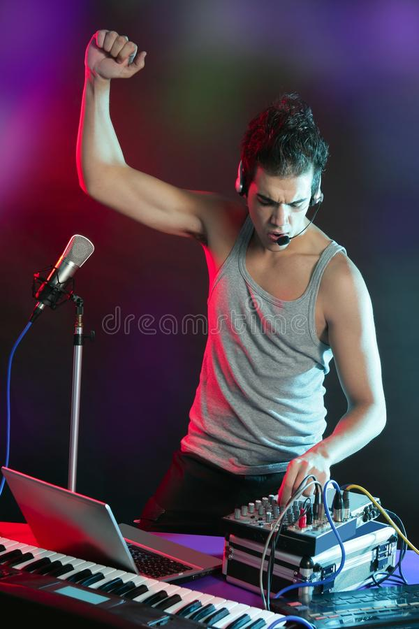 Dj with colorful light and music mixing equipment. Dj with colorful light and music mixing digital equipment stock photos